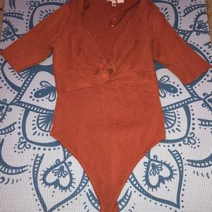 This is a chestnut colored bodysuit, super cute!!